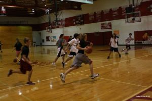File photo: Students play basketball in PE class. Intramurals use PE rules. Photo by: Shelby Fleming
