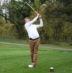 Senior Noah Fenske drives a shot. Photo by Emma Winckel.