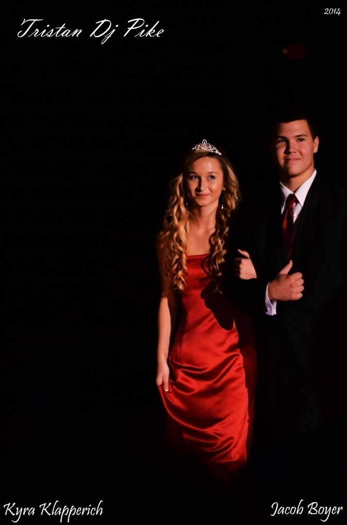 Members of the senior homecoming court walk to the stage. Photo by Tristan Pike.