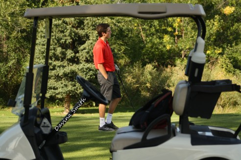 Senior Tucker Berg scopes out the course. Photo by Davina Smith.