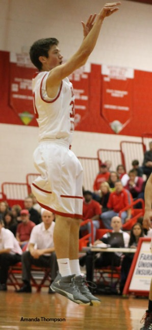 Senior Tucker Berg rises for a shot last season. Photo by Amanda Thompson
