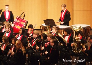 Connor (middle) plays the saxaphone for a band concert last year. Photo by Tameeka VanHout.