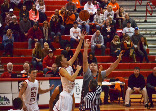 Tanner takes the opening tipoff against Natrona. Photo by Taber Oman.